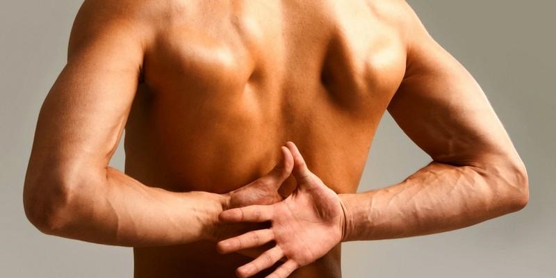 Болит позвоночник посередине спины