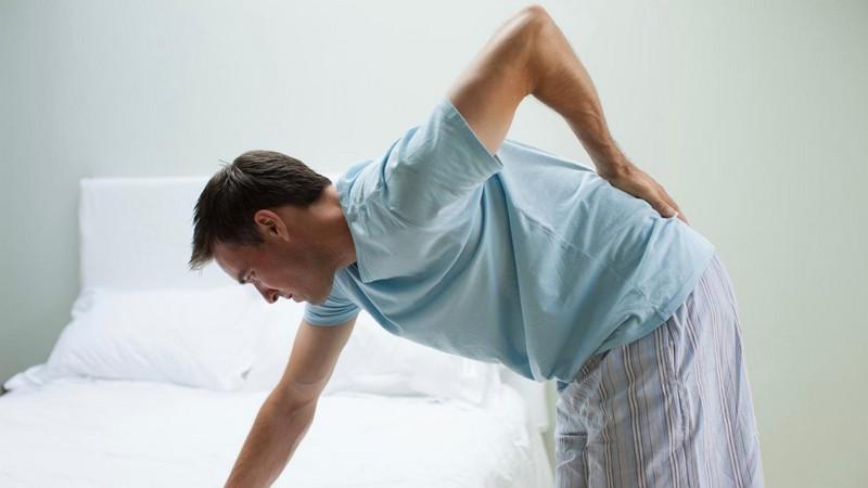 растяжение мышц и боль в пояснице